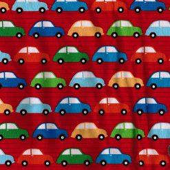 Tissu aux motifs de petites voitures colorées sur fond rouge - Artigina
